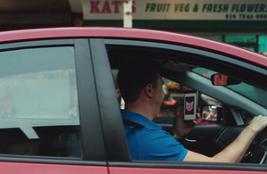 Driver distracted by using a mobile phone.