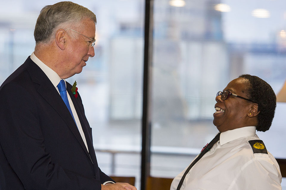 Sir Michael Fallon congratulated Chief Petty Officer Evadne Gordon for becoming the longest serving female member of the Royal Naval Reserves.