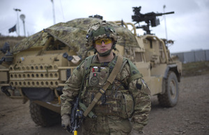 Kingsman Jordan Broome in front of a Jackal all-terrain weapons platform on Salisbury Plain [Picture: Richard Watt, Crown copyright]