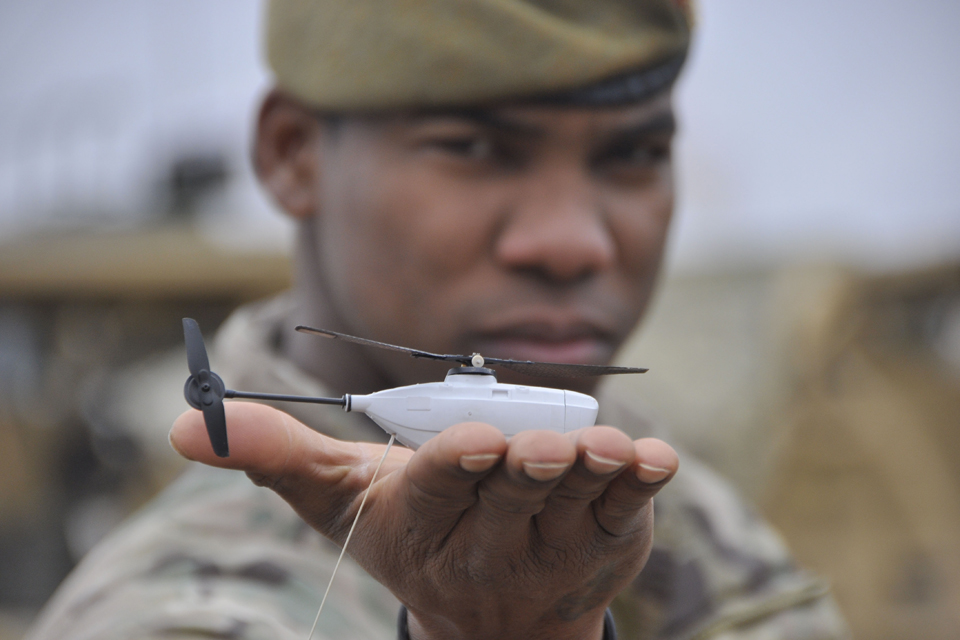 Soldier holding a Black Hornet Nano Unmanned Air Vehicle