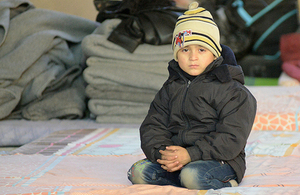 A Syrian boy in a shelter in Jibreen, Syria, December 2016. UK aid helped UNICEF provide support to children across Syria last winter, and is doing so again this year. Picture: UNICEF/Rzehak