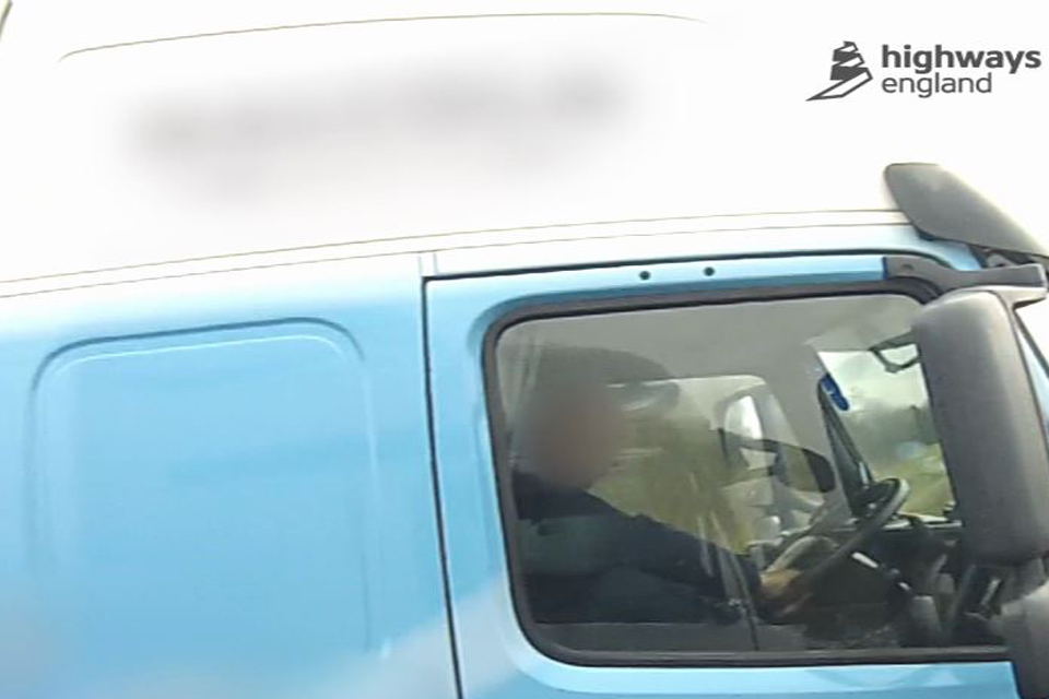 Image of driver with foot on the dashboard