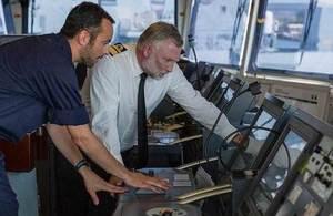 RAdm Tim Lowe and Lt Kyle Walkley on board HMS Gleaner