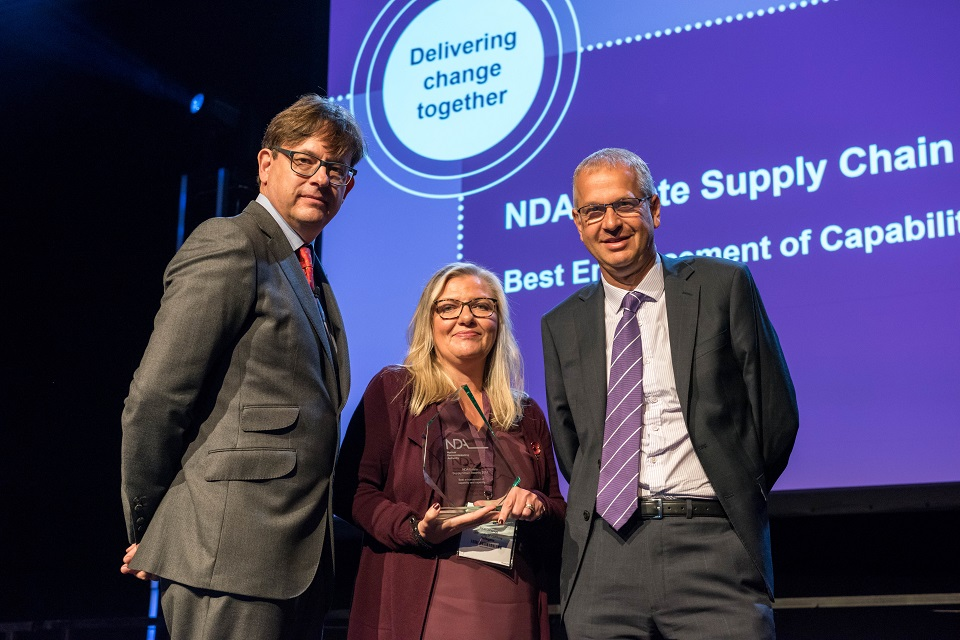 Jacqueline Longrigg from the University of Cumbria receives the skills award from Ron Gorham (left), NDA Head of Supply Chain,  and NDA HR Director David Vineall