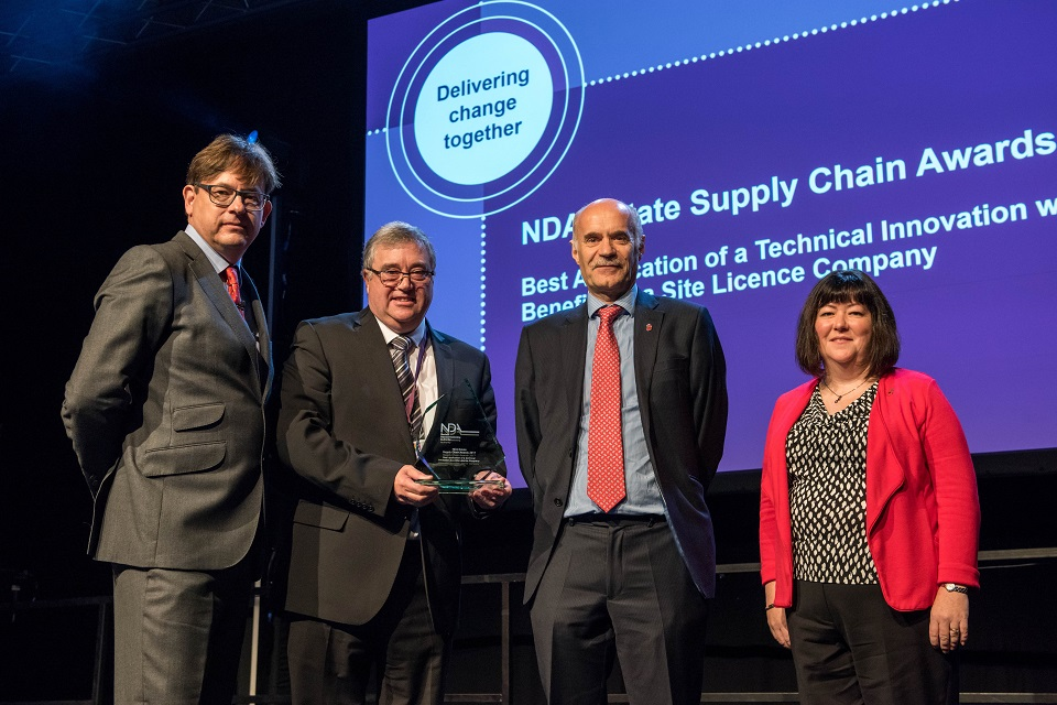 Nuvia's Phil Nelson (second left) collects the innovation award from Ron Gorham, Derek Allen from Innovate UK and NDA Head of Technology Melanie Brownridge