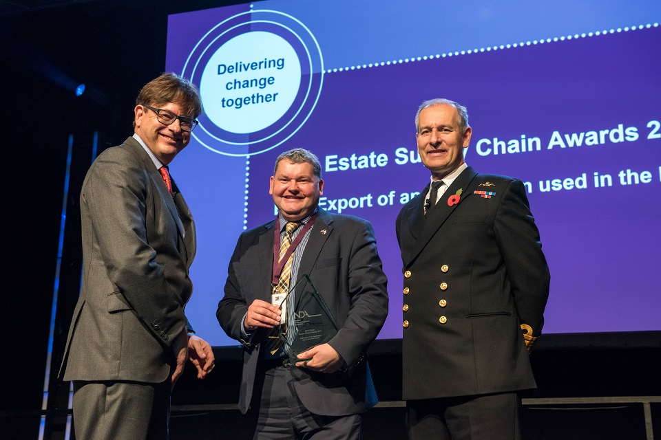 Mark Sharpe of Oxford Technologies, who won the export award, with Ron Gorham and Rear Admiral Keith Beckett