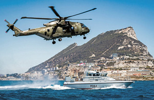 Commando Helicopter Force Merlin Mk3 helicopter and HMS Scimitar in British Gibraltar Territorial Waters. Crown copyright.