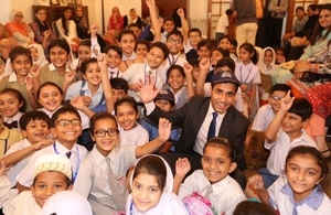 Mr. Rehman Chishti MP school children at an event organised for the British publisher Ladybird at the Deputy High Commission