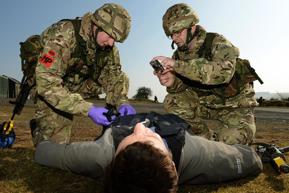 Trained crime scene investigators process a 'crime scene'