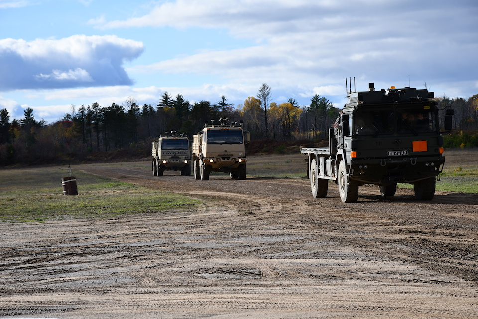 A British Army MAN SV 6-tonne truck leading two US Light Medium Tactical Vehicle trucks in a driverless convoy.