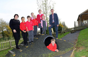 Image showing Katy Stephens, Amey's Principal Operations Manager, with Mark Humpage from Highways England and children from St Thomas More Catholic Primary School