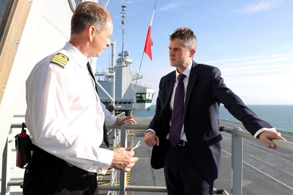 Defence Secretary Gavin Williamson meets Royal Navy Captain Jerry Kyd on board HMS Queen Elizabeth.