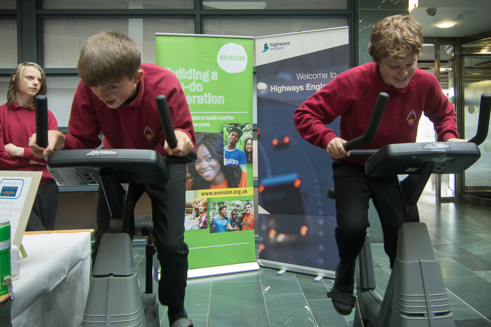 Image of two students on cycling machine