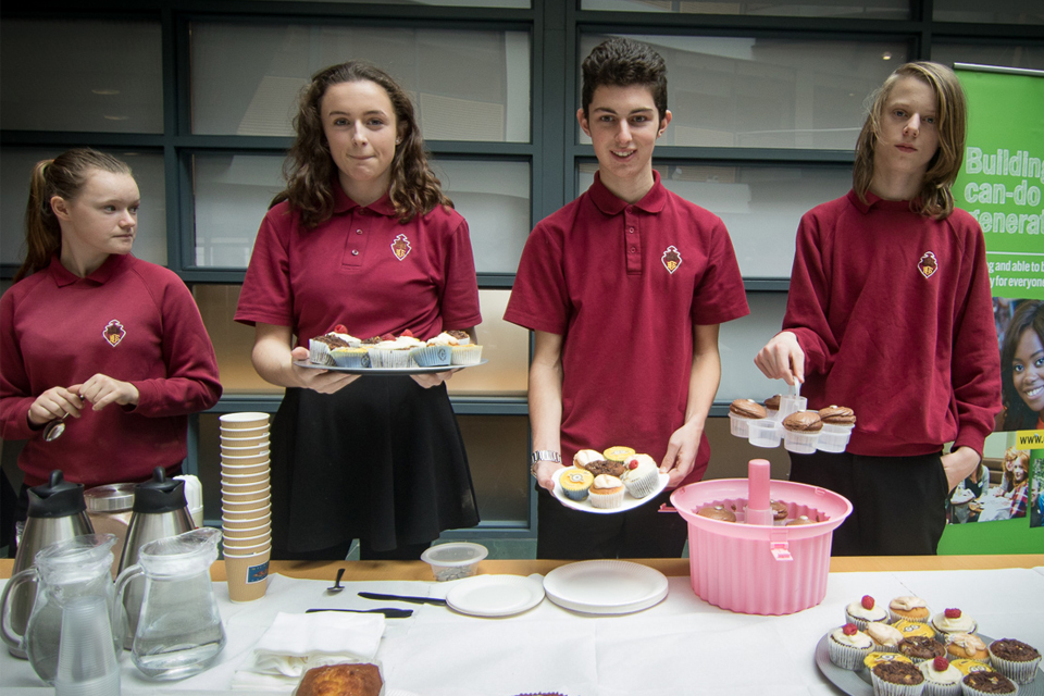 Image of students with cakes