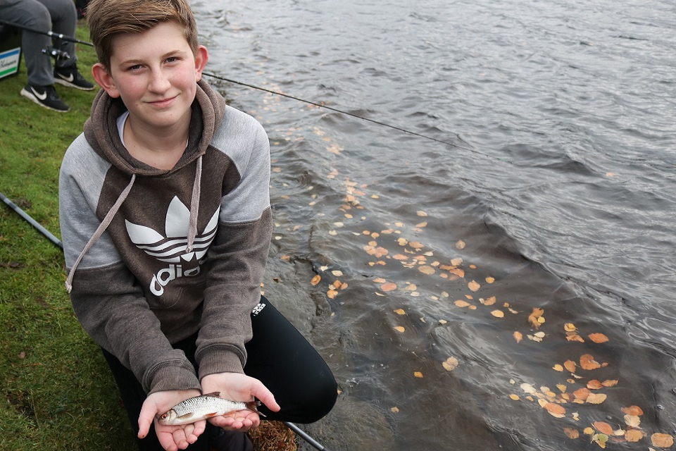 Image shows youngsters Jack Canham with the fish he caught.