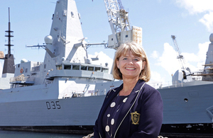 Defence Minister Harriett Baldwin in front of Type 45 destroyer HMS Dragon. Crown copyright.