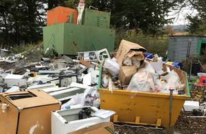 A piles of waste that was illegally dumped on some land in Somerset