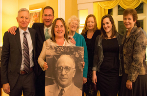 Frank Foley's family holding photo of Frank Foley