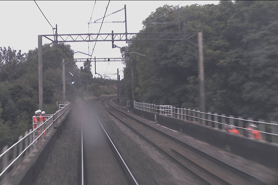 Image from a northbound train (on the down line) at 16:54 hrs. The down side sub-team can be seen in a refuge. The up side sub-team can be seen on the right, stood on the string course. (Image courtesy of Virgin Trains)