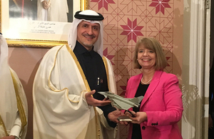 Defence Minister Harriett Baldwin hands a model Typhoon to His Excellency Mr Yousef Ali Al-Khater. Crown copyright.