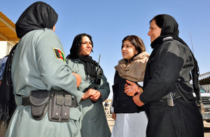 Foreign Office Senior Minister of State, Baroness Warsi with police women at Helmand Provincial Police Headquarters