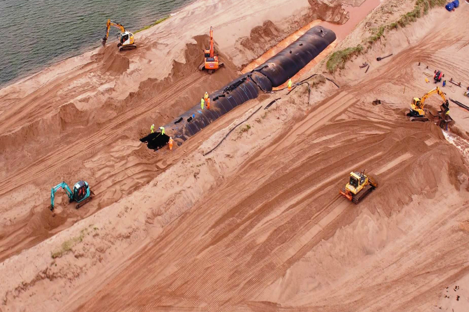 An aerial view of the giant bags of sand being buried beneath the dunes at Dawlish Warren.