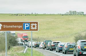 Photo of traffic going past Stonehenge