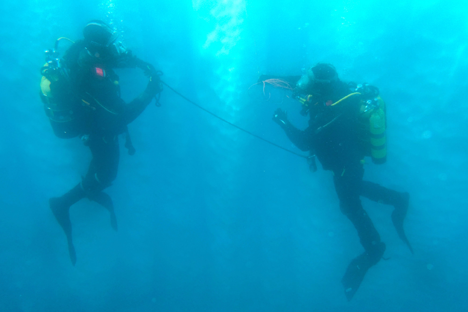 Divers in icy waters