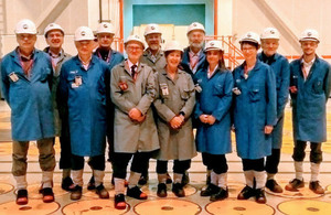 Committee members standing in Sellafield