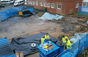 Aerial view of Environment Agency officers dealing with an diesel oil pollution at Christchurch hospital