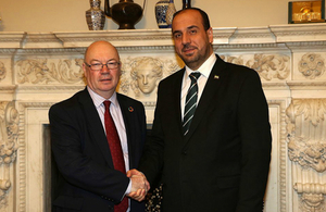 Minister Alistair Burt shaking hands with Nasser Hariri from the Syrian Negotiation Commission
