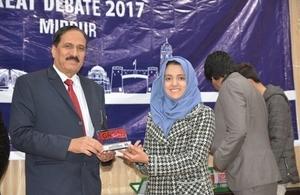 Great debate winner, Afifa Awais receiving award
