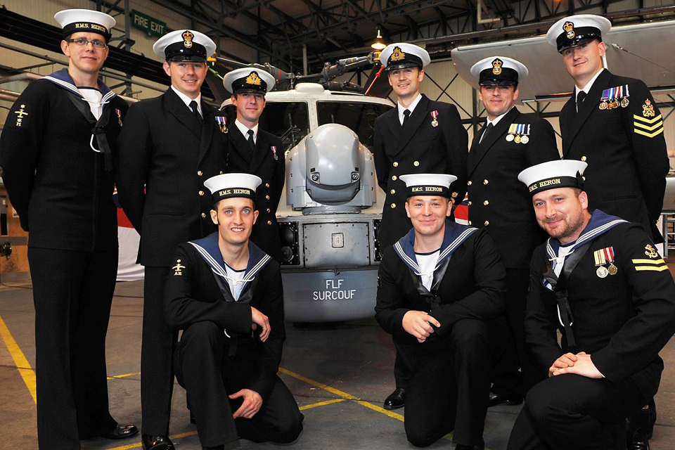 Members of 217 Flight pose in front of their Lynx helicopter