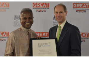 Kushil Gunasekera receiving his Commonwealth Point of Light Award from His Royal Highness The Prince Edward, Earl of Wessex