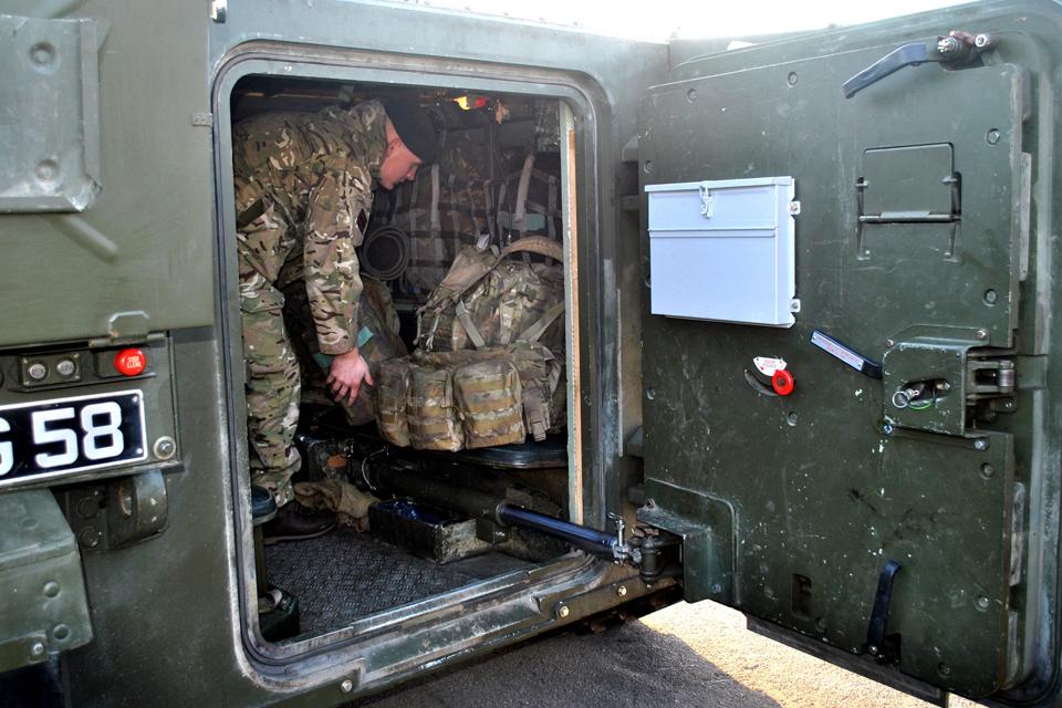 A Rifleman packs his kit