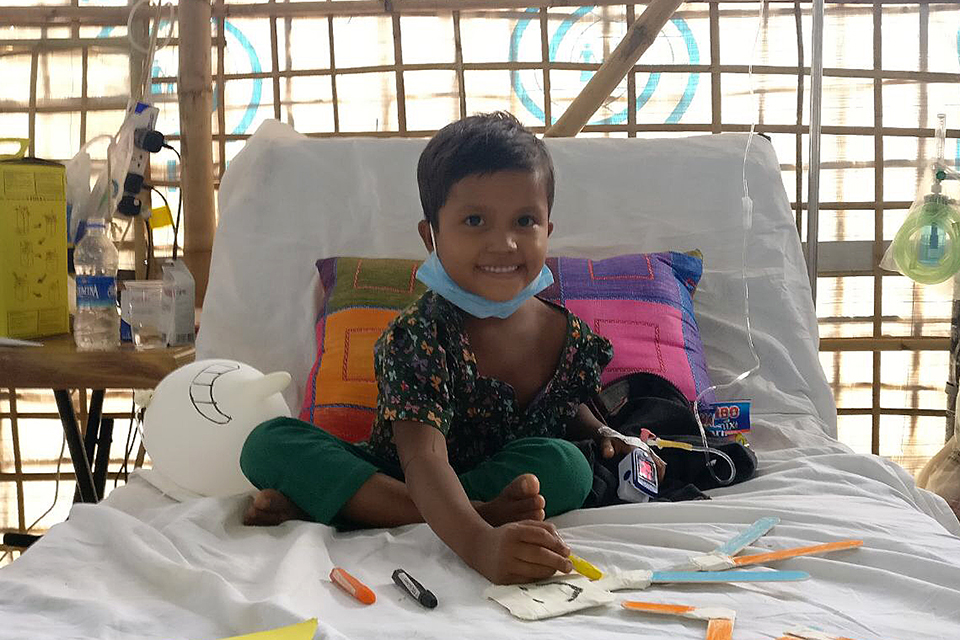 Six-year-old Sumaiya, sitting up in bed and already recovering after receiving diphtheria antitoxin treatment.