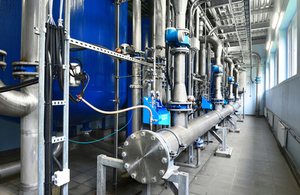 Large industrial water treatment and boiler room. By Aleksey Stemmer at Shutterstock.com.