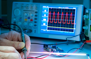 Photograph of a person using electronic test equipment