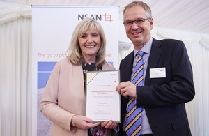 David Vineall receives the certificate of thanks from Jo Tipa, of NSAN