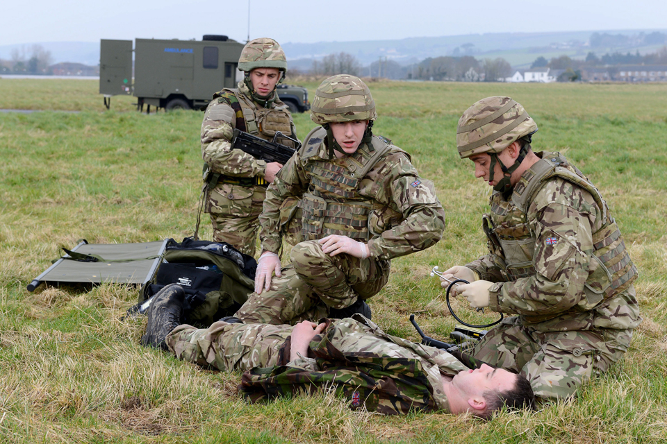 Commandos providing first aid to a battlefield 'casualty'