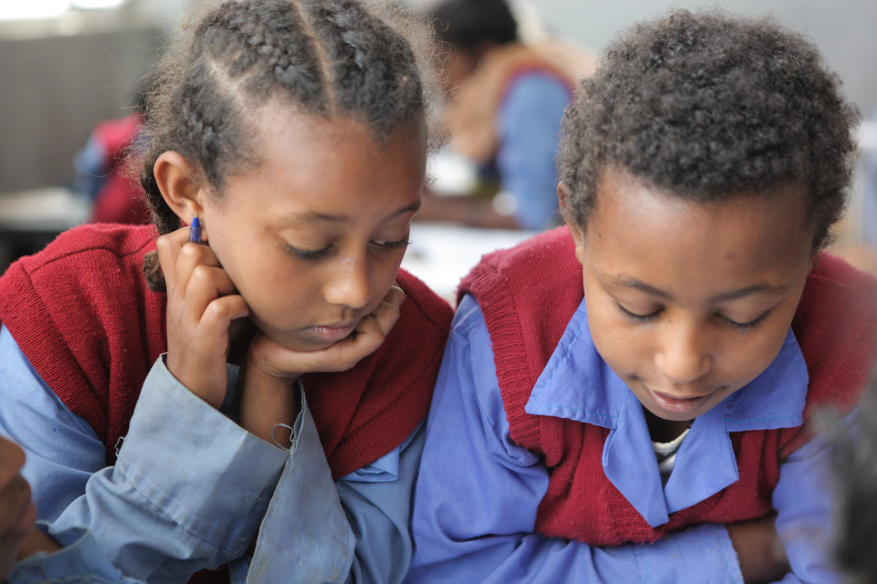 A girl and her classmate read. Hidassie school, Addis Ababa, Ethiopia. GPE/Midastouch