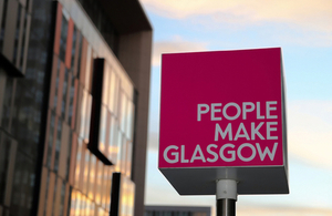 People Make Glasgow signs stands in front of the Technology and Innovation Centre by Worldviews at Shutterstock.com