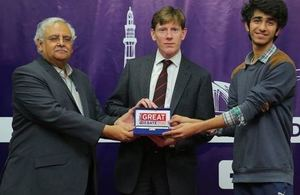 The British Deputy High Commissioner Richard Crowder giving award to the winner
