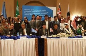 DFID Head, Joanna Reid and KP education Minister, Atif Khan with other guests at the signing ceremony.