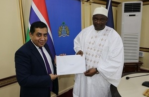 Lord Ahmad handing the Commonwealth Heads of Government Meeting invitation to President Barrow