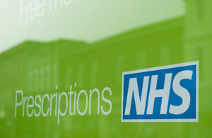 NHS prescriptions sign in pharmacy shop window