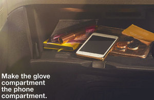 Mobile phone in a car glove compartment.