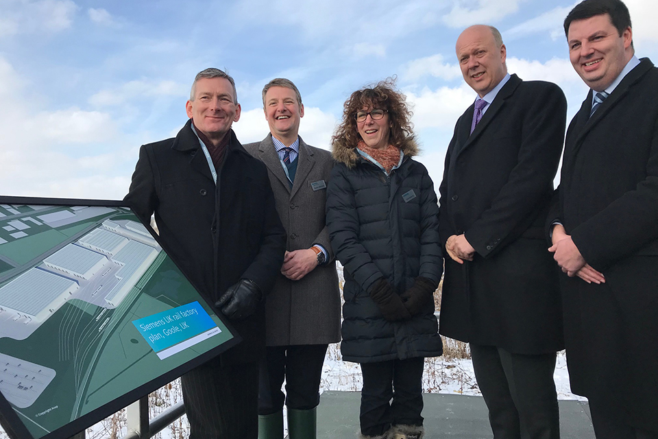 Transport Secretary with Andrew Percy, MP for Brigg and Goole and Siemens staff at the site of the planned train factory in Goole.