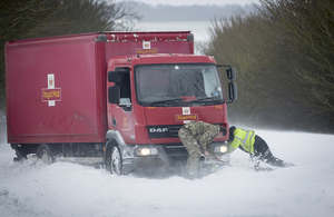 RAF personnel assist with vehicles stuck in the snow