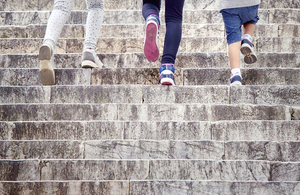 Running up steps.